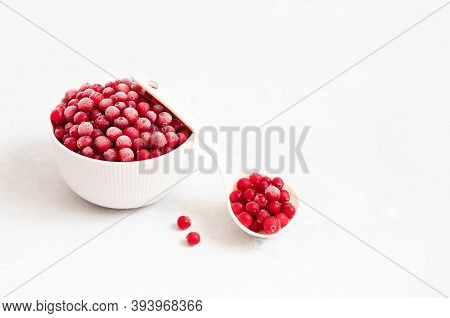 Frozen Berries In A Bowl On A White Background. Red Berries Covered With Frost. Frozen Food. Space F