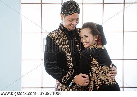 Portrait Happy Men And Women Wearing Javanese Traditional Clothes.