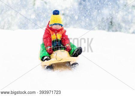 Boy On Sled Ride. Child Sledding. Kid On Sledge