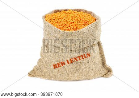 Red Lentils In A Sack Isolated On A White Background. Red Lentils In A Burlap Sack. Healthy Food. Re