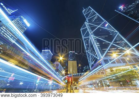 Traffic In Downtown District Of Hong Kong City At Night