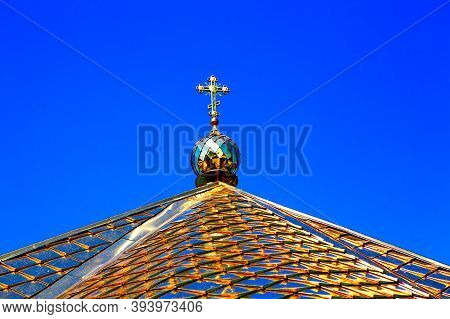 Steeple With Golden Roof And Cross On The Top