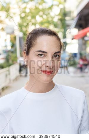 Portrait Of A Woman With Updo Hair, Casual, Natural Look, Slim, Outdoors, Soft Smile.