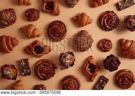 Assortment Of Tasty Sugary Confectionery Products In Variety Flavor. Freshly Baked Buns, Criossants,
