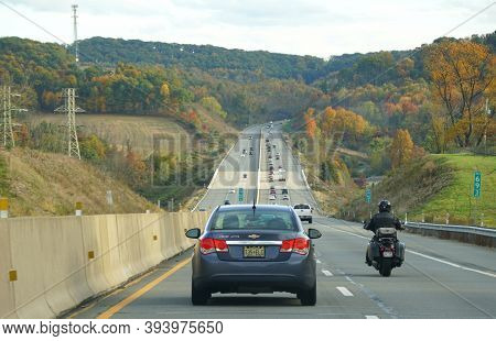 Clark Summit, Pennsylvania, U.s.a - October 20, 2020 - Traffic On Pa Turnpike Surrounded By Striking