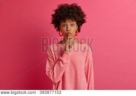 Photo Of Dark Skinned Woman Presses Index Finger To Lips, Demands Keep Silence, Shushing Mysteriousl