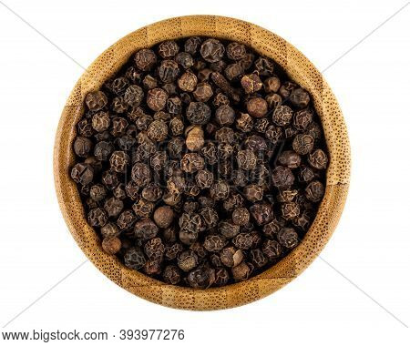Bamboo Bowl With Peppercorn Isolated On White Background. Top View