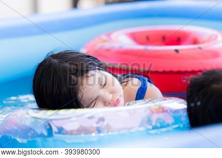 Children Sleep In The Pool. Dangerous If Letting Children Swim Without Adult Supervision Closely. Sa