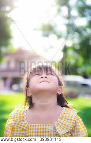 Vertical Photos Of Bright Young Girls Looking Up At The Sky. Focus On The Smiling Lips Of The Asian