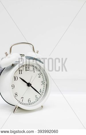 Old Alarm Clock With Twenty Minutes Past Ten. Date And Time Reminder Or Deadline Concept, Small Cloc