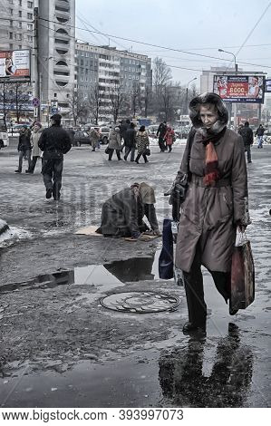 Russia, St. Petersburg 28,12,2012 Beggar Begging On His Knees In The Slush