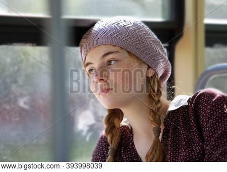 Portrait Of A Nice Freckled Teenage Girl With Pigtails Dressed In Retro Style Clothes In A Wagon Of