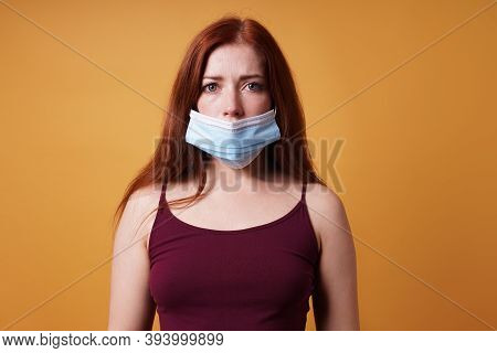 Young Woman Wearing Medical Face Mask Wrong Leaving Nose Uncovered - Improper Use Of Protective Coro