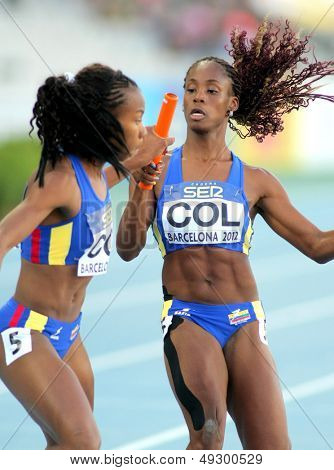 BARCELONA - JULY, 14: J. Largacha(R) and E. Aguilar(L) of Colombia competes on 4X400 Relay of the 20th World Junior Athletics Championships at the Olympic Stadium on July 14, 2012 in Barcelona, Spain