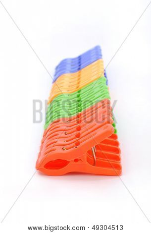 Colorful clothes pins on white background