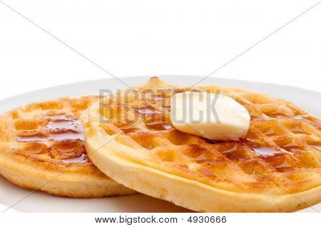 Breakfast Waffles With Butter And Maple Syrup