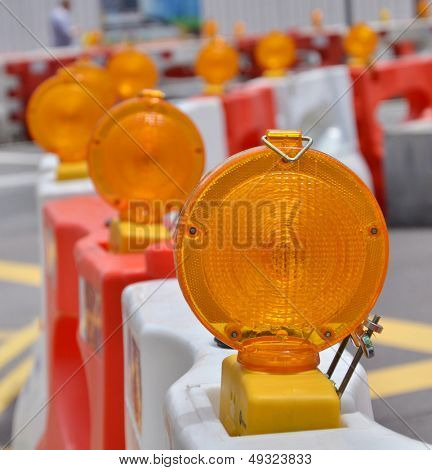 Orange construction light on barricade