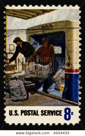 A 1973 issued 8 cent United States postage stamp showing US Postal Service Employees. poster