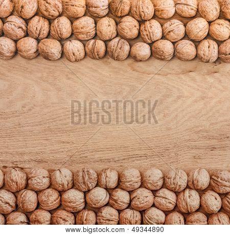 Unshelled Walnuts Lying On Desk
