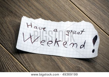 Have a great Weekend - Hand writing text on a piece of paper on wood background poster