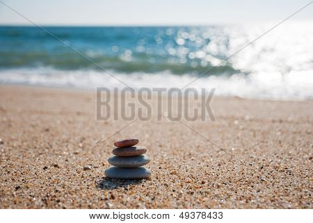 Stack Of Pebble Stones On The Beach