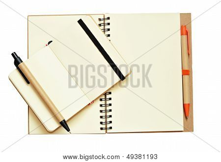 Opend Notebooks And Pens