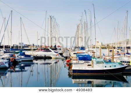 Row Of Boats Docked At Howth Harbor In Ireland