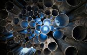 Metal tubes with light. Abstract industrial background poster