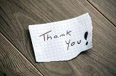 Thank you - Hand writing text on wood background poster