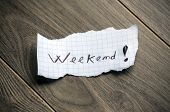 Weekend - Hand writing text on a piece of paper on wood background poster