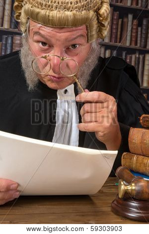 Funny old judge looking through a lorgnette