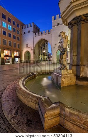 Brunnenbuberl Fountain and Karlstor Gate in the Evening Munich Germany poster