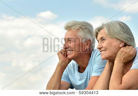 Elderly couple went to the beach