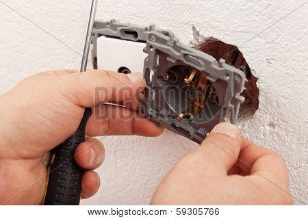 Electrician Hands Mounting Electric Wall Fixture