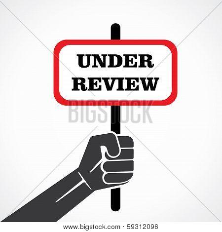 under review word banner held in hand stock vector