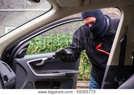 Car Burglar In Action