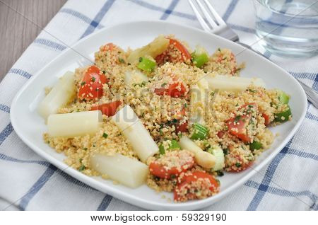 Couscous Salad with tomatoes, peas and asparagus
