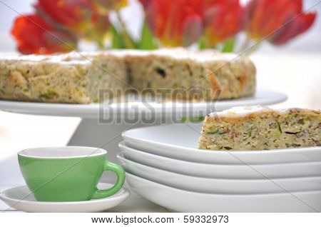 Healthy Zucchini Cake with tulips in the background