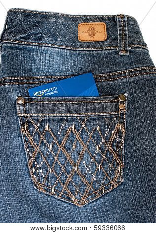DAYTON, OHIO - FEBRUARY 2, 2014: Bandolino jeans pocket with Amazon credit card. Bandolino is fashions by designer, Enzo Anioglini; Amazon is the worlds largest online retailer operating since 1995.