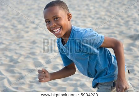 Boy Running With Sand