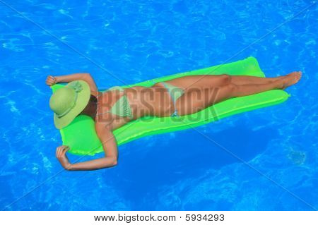 Woman Enjoying A Swimming Pool