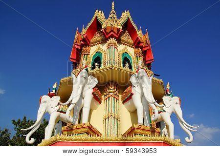 Wat Tham Suea.  Kanchanaburi, Thailand at sunset. poster