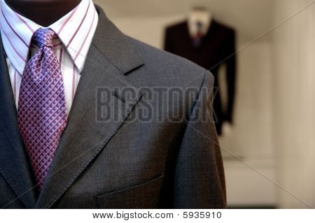 Business suits on shop mannequins high fashion retail display poster