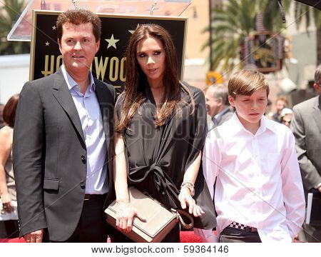 LOS ANGELES - MAY 23:  Simon Fuller, Victoria Beckham & son Brooklyn arrives to the Walk of Fame Ceremony for Simon Fuller  on May 23, 2011 in Hollywood, CA