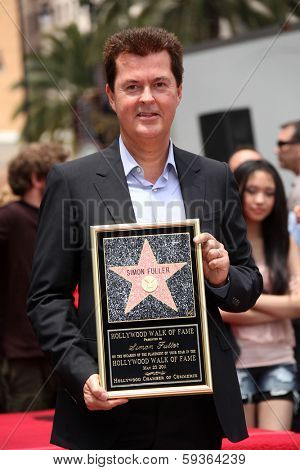 LOS ANGELES - MAY 23:  Simon Fuller arrives to the Walk of Fame Ceremony for Simon Fuller  on May 23, 2011 in Hollywood, CA