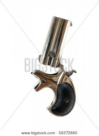 Antique derringer isolated over white in the opened position