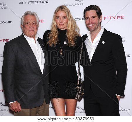 LOS ANGELES - NOV 19:  George Lazenby, Jodie Kidd and David Blakeley arrives to the Jaguar F-TYPE Global Reveal Event  on November 19, 2013 in Playa Vista, CA