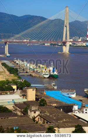 stayed-cable bridge and boatyard in the minjiang river poster