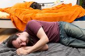 a Dog and Man change roles of sleeping poster