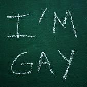 sentence I am gay written in a chalkboard poster